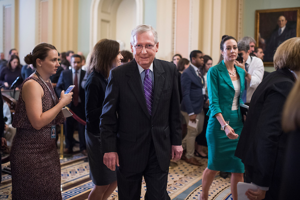 UNITED STATES - SEPTEMBER 25: Senate Majority Leader Mitch McConnell, R-Ky., makes his way through reporters and staff in the Capitol after the Senate policy luncheons on September 25, 2018. (Photo By Tom Williams/CQ Roll Call)