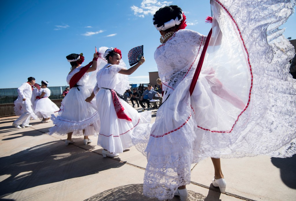 Dancers with the Mexico Vivo group prepares to perform at the East Las Vegas Community Center, an early voting location, in Las Vegas on Saturday, Oct. 20, 2018, the first day of early voting in Nevada. (Photo By Bill Clark/CQ Roll Call)
