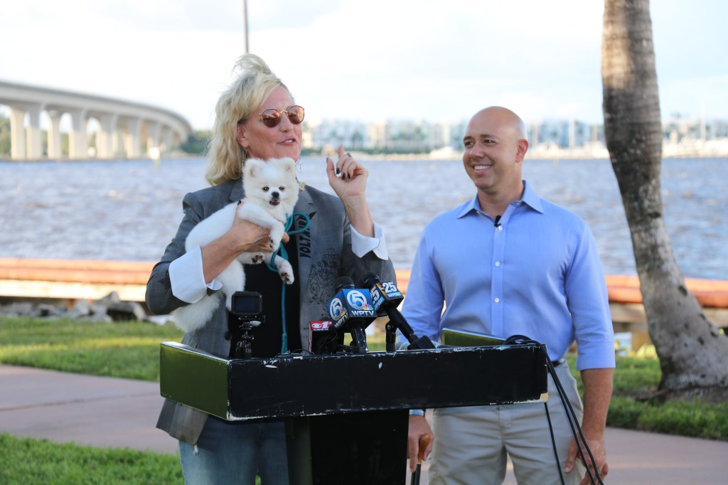 Erin Brockovich holds Pandora, a miniature Pomeranian who was diagnosed with acute liver failure expected to be from contact from algae after eating a fish along beach of the St. Lucie River. (Courtesy Mast)
