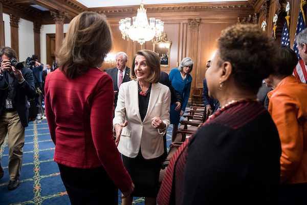 UNITED STATES - NOVEMBER 30: From left, Rep. Cheri Bustos, D-Ill., House Minority Leader Nancy Pelosi, D-Calif., and Rep. Barbara Lee, D-Calif., talk after the incoming House Democratic leadership team posed for a group photo in the Rayburn Room in the U.S. Capitol on Friday, Nov. 30, 2018. (Photo By Bill Clark/CQ Roll Call)