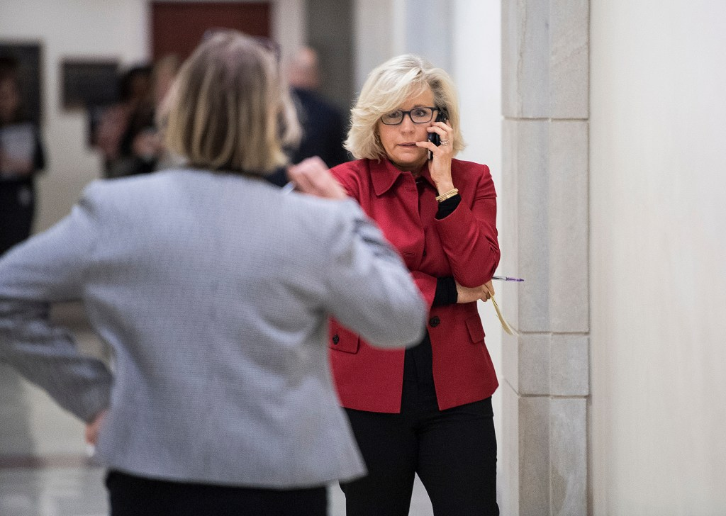House Republican Conference Chair Liz Cheney, R-Wyo., talks on her phone in the hallway outside of the House GOP leadership press conference on Wednesday, Jan. 23, 2019. Republicans announced their annual retreat would be postponed due to the government shutdown. (Bill Clark/CQ Roll Call)