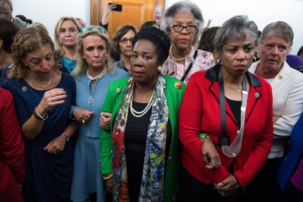 Reps. Debbie Wasserman Schultz, D-Fla., Carolyn Maloney, D-N.Y., Debbie Dingell, D-Mich., Suzanne Bonamici, D-Ore., Sheila Jackson Lee, D-Texas, Joyce Beatty, D-Ohio, Brenda Lawrence, D-Mich., and Julia Brownley, D-Calif. waited to enter the Senate Judiciary Committee vote on Brett Kavanaugh. (Tom Williams/CQ Roll Call)