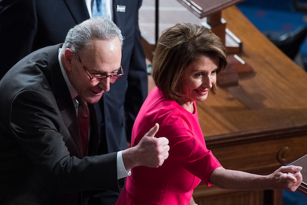 Speaker Nancy Pelosi, D-Calif., greets Senate Minority Leader Charles Schumer, D-N.Y., before she won the speakership in the Capitol's House chamber on the first day of the 116th Congress on January 3, 2019. (Tom Williams/CQ Roll Call)