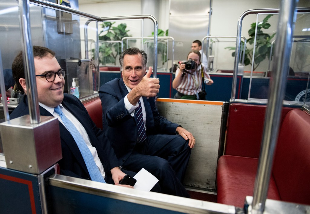 UNITED STATES - JANUARY 10: Sen. Mitt Romney, R-Utah, gives a thumbs up to photographers as he boards the Senate subway to the Russell building in the Capitol on Thursday, Jan. 10, 2019. (Photo By Bill Clark/CQ Roll Call)