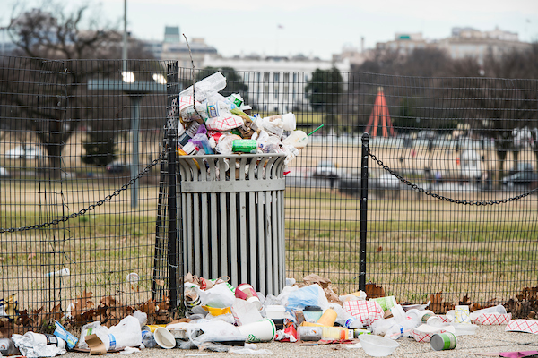 Garbage overflows a trash can on the National Mall across from the White House on Tuesday, Jan. 1, 2019. The National Park Service, which is responsible for trash removal, is not operating due to the government shut down. (Bill Clark/CQ Roll Call)
