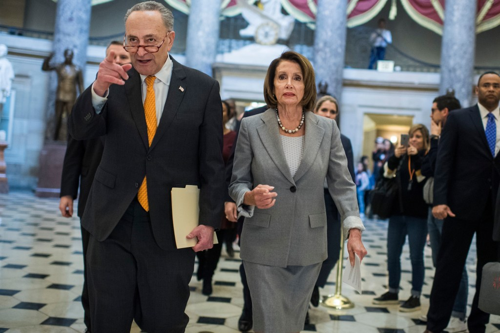 UNITED STATES - JANUARY 9: Speaker Nancy Pelosi, D-Calif., and Senate Minority Leader Charles Schumer, D-N.Y., are pictured in the Capitol's Statuary Hall before a news conference on how the partial government shutdown is effecting furloughed workers and families on January 9, 2019. (Photo By Tom Williams/CQ Roll Call)