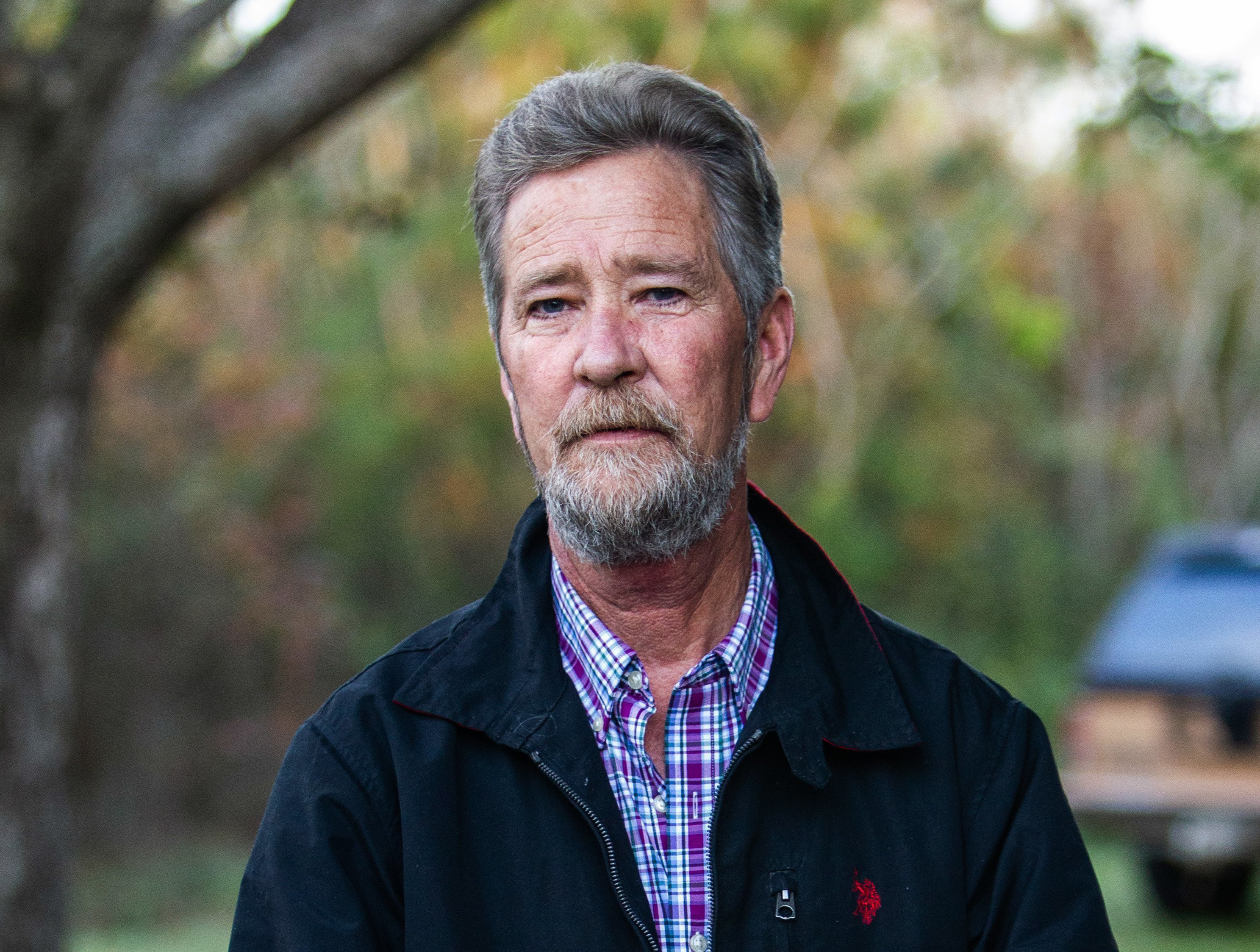 Leslie McCrae Dowless Jr. poses for a portrait outside of his home in Bladenboro, N.C. on Dec. 5, 2018. (Travis Long/The News & Observer via AP, File)