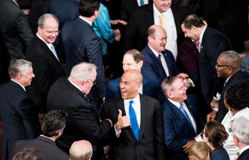 UNITED STATES - FEBRUARY 5: Sen. Cory Booker, D-N.J., gives a thumbs up to Rep. Billy Long, R-Mo., as Senators arrive in the House chamber for President Donald Trump's State of the Union Address to a joint session of Congress in the Capitol on Tuesday, Feb. 5, 2019. (Photo By Bill Clark/CQ Roll Call)