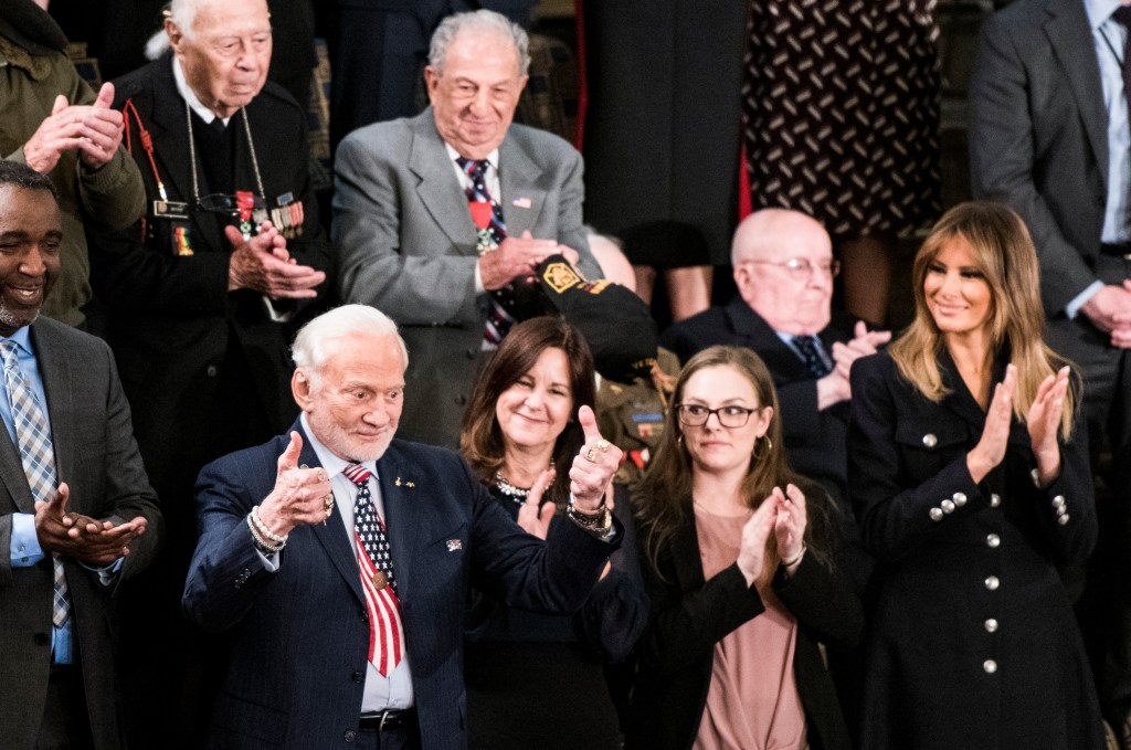 UNITED STATES - FEBRUARY 5: Apollo 11 astronaut Buzz Aldrin, left, gives a thumbs up as First Lady Melania Trump claps after he is introduced during President Donald Trump's State of the Union Address to a joint session of Congress in the Capitol on Tuesday, Feb. 5, 2019. (Photo By Bill Clark/CQ Roll Call)