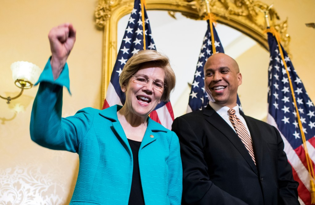 Sen. Cory Booker, D-N.J., and Sen. Elizabeth Warren, D-Mass., hold their news conference in the Capitol to introduce the
