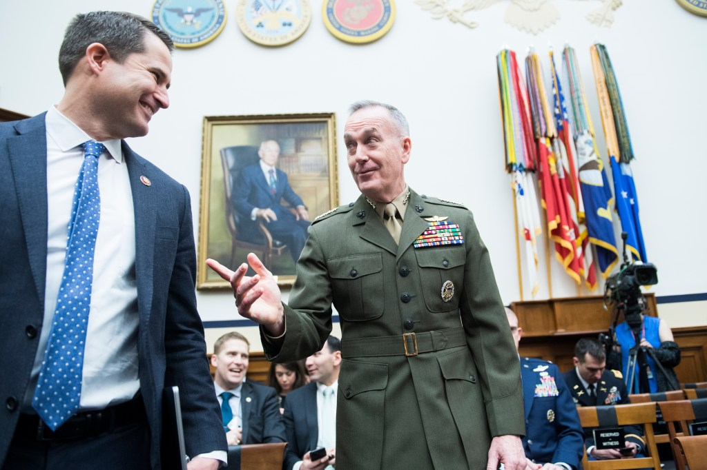 UNITED STATES - MARCH 26: Gen. Joseph F. Dunford, chairman of the Joint Chiefs of Staff, and Rep. Seth Moulton, D-Mass., talk before a House Armed Services Committee hearing in Rayburn Building titled the
