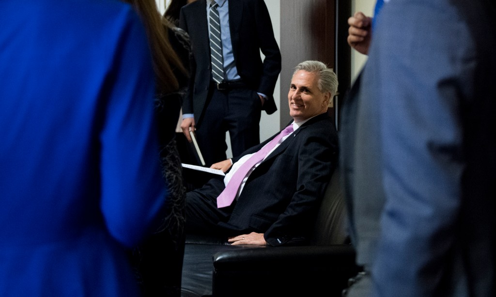 UNITED STATES - MARCH 26: House Minority Leader Kevin McCarthy, R-Calif., waits in the green room with staff before the start of the House GOP post-caucus press conference in the Capitol on Tuesday, March 26, 2019. (Photo By Bill Clark/CQ Roll Call)