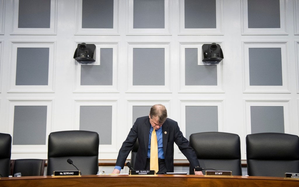 UNITED STATES - MARCH 13: Rep. Mike Quigley, D-Ill., prepares to chair the House Appropriations Subcommittee on Financial Services and General Government Subcommittee hearing on