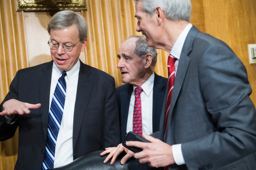 From left, Jim Talent, commissioner of the U.S.-China Economic and Security Review Commission, Chairman James Risch, R-Idaho, and Sen. Rob Portman, R-Ohio, arrive for a Senate Foreign Relations Committee in Dirksen Building titled