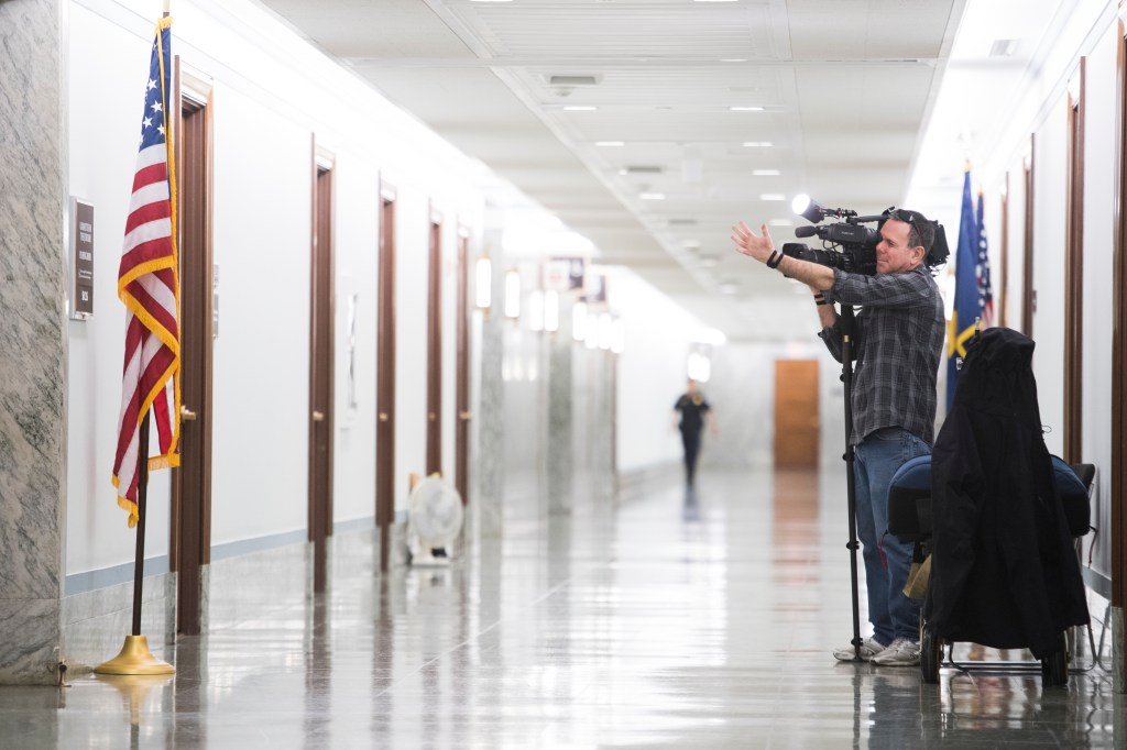 A cameraman stakes out the Senate Judiciary office in Dirksen Building prior to delivery of special counsel Robert Mueller's report on Russian interference in the 2016 election on Sunday, March 24, 2019. The report was delivered electronically to Congressional offices. (Tom Williams/CQ Roll Call)