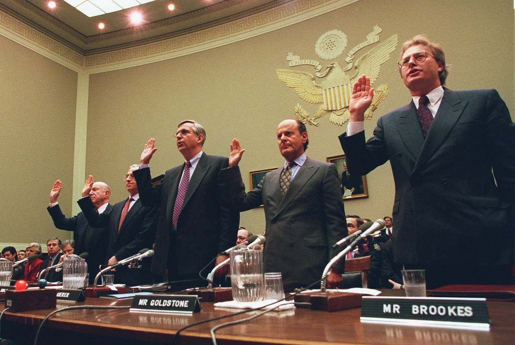 The witnesses are sworn in during the tobacco hearings before the House Committee on Commerce in January 1998. The witnesses from left to right are,Laurence A. Tisch,Co Chairman of Loews Corp.,Geoffrey Bible,Chairman Of Philip Morris,Vincent A. Gierer,Jr.,CEO UST,Inc.,Steven F. Goldstone,CEO(CONGRESSIONAL QUARTERLY PHOTO BY DOUGLAS GRAHAM)