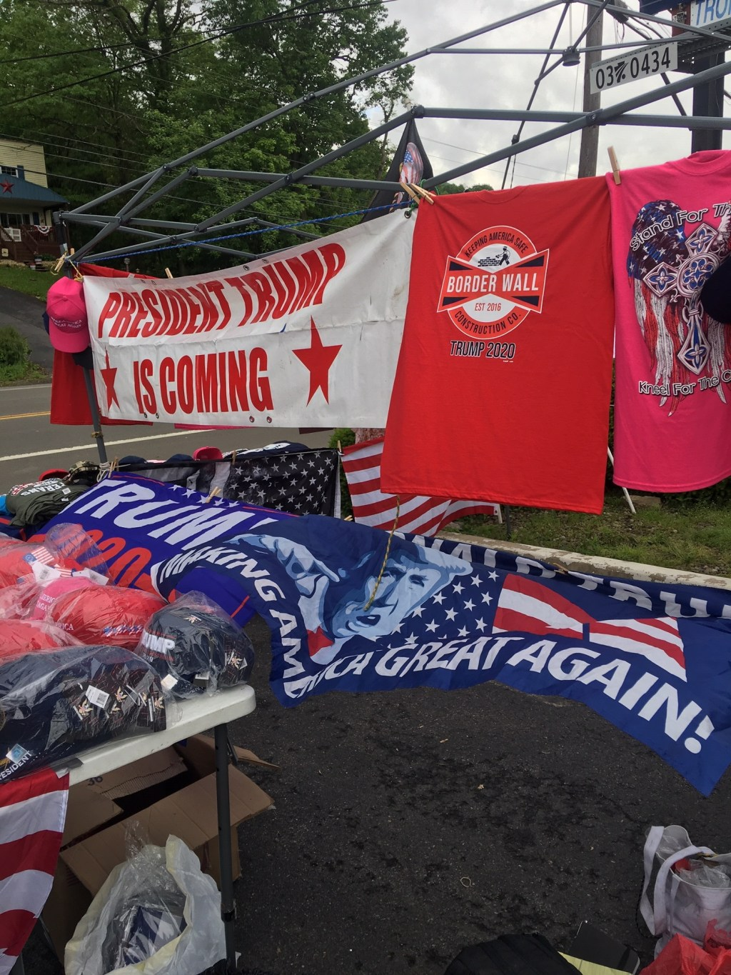 Terri Bruner's pro-Trump merchandise stand greeted passersby in Williamsport ahead of President Trump's Monday evening rally. (John T. Bennett/CQ Roll Call)