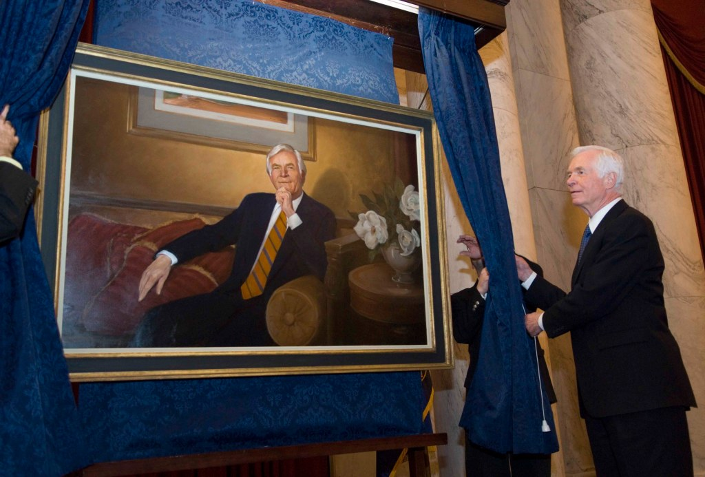 03/16/06.COCHRAN PORTRAIT UNVEILING--Former Agriculture Chairman (2003-04) Thad Cochran, R-Miss., unveils a portrait of himself during a reception in the Russell Senate Office Building. Cochran is currently chairman of Senate Appropriations. The portrait, to hang in the Senate Agriculture Committee room, was painted by Marshall Bouldin, of Clarksdale, Miss., who has more portraits hanging in the U.S. Capitol than any living artist. CONGRESSIONAL QUARTERLY PHOTO BY SCOTT J. FERRELL