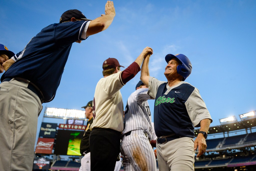UNITED STATES - JUNE 26: Rep. Ed Permutter, D-Colo., is congratulated by his teammates after scoring a run during the 58th annual Congressional Baseball Game at Nationals Park on Wednesday June 26, 2019. (Photo by Caroline Brehman/CQ Roll Call)
