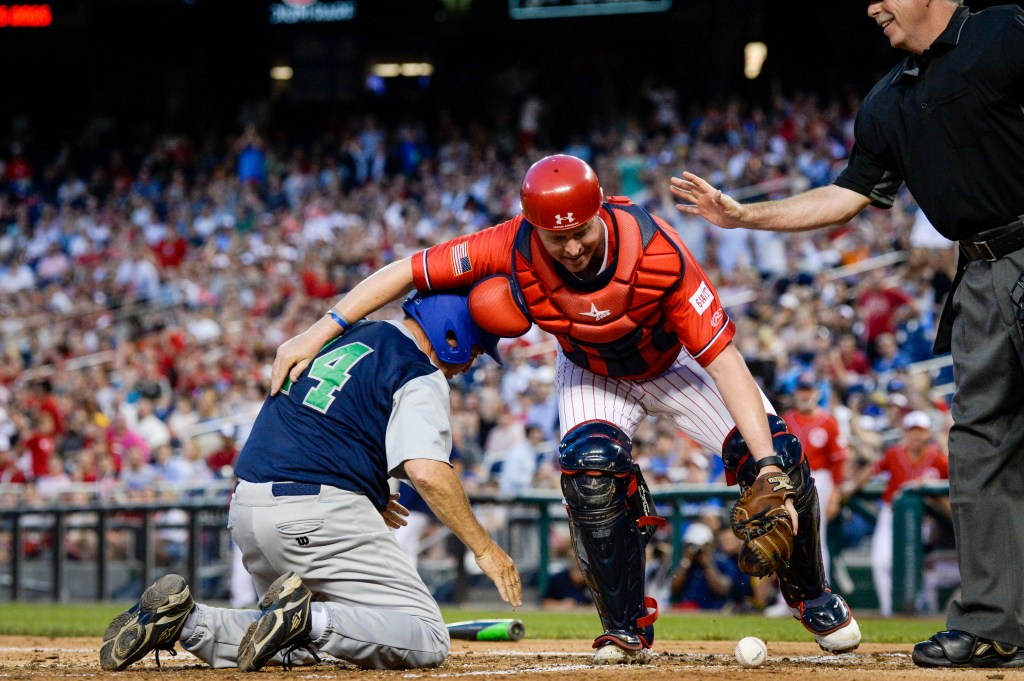 UNITED STATES - JUNE 26: Rep. Ed Perlmutter, D-Colo., left, collides with Rep. Rodney Davis, R-Ill., at the plate during the 58th annual Congressional Baseball Game at Nationals Park on Wednesday June 26, 2019. (Photo by Caroline Brehman/CQ Roll Call)
