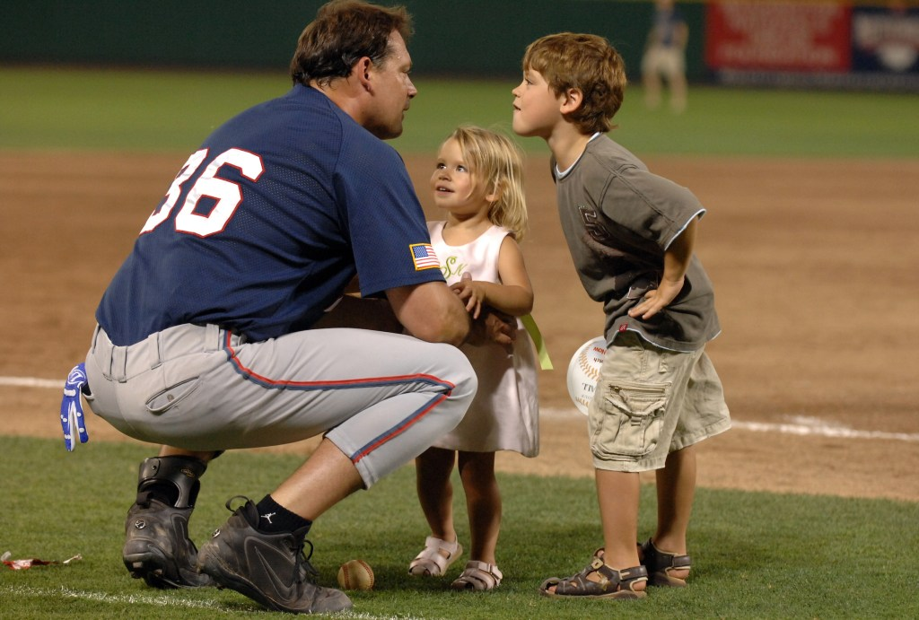 Rep. Heath Shuler, D-N.C., talks with his daughter Island, 2 1/2, and son Navy, 6, after the 46th Annual Roll Call Congressional Baseball Game.