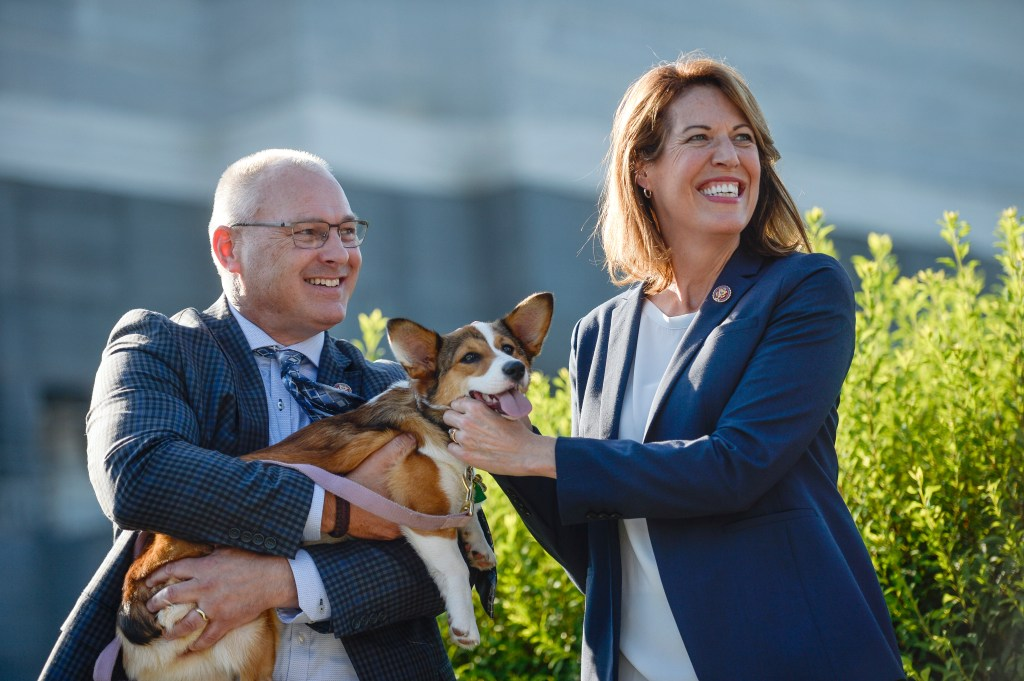 UNITED STATES - JULY 15: Rep. Pete Stauber, R-Minn., left, and Rep. Cindy Axne, D-Iowa., hold a dog during a news conference about calling for the passage of federal animal cruelty law on Capitol Hill on Monday July 15, 2019. (Photo by Caroline Brehman/CQ Roll Call)