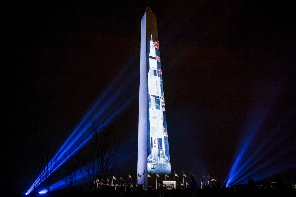 UNITED STATES - JULY 16: The image of a Saturn V, the rocket that sent Apollo 11 into orbit on July 16, 1969, is projected on the Washington Monument on Tuesday July 16, 2019. (Photo by Caroline Brehman/CQ Roll Call)