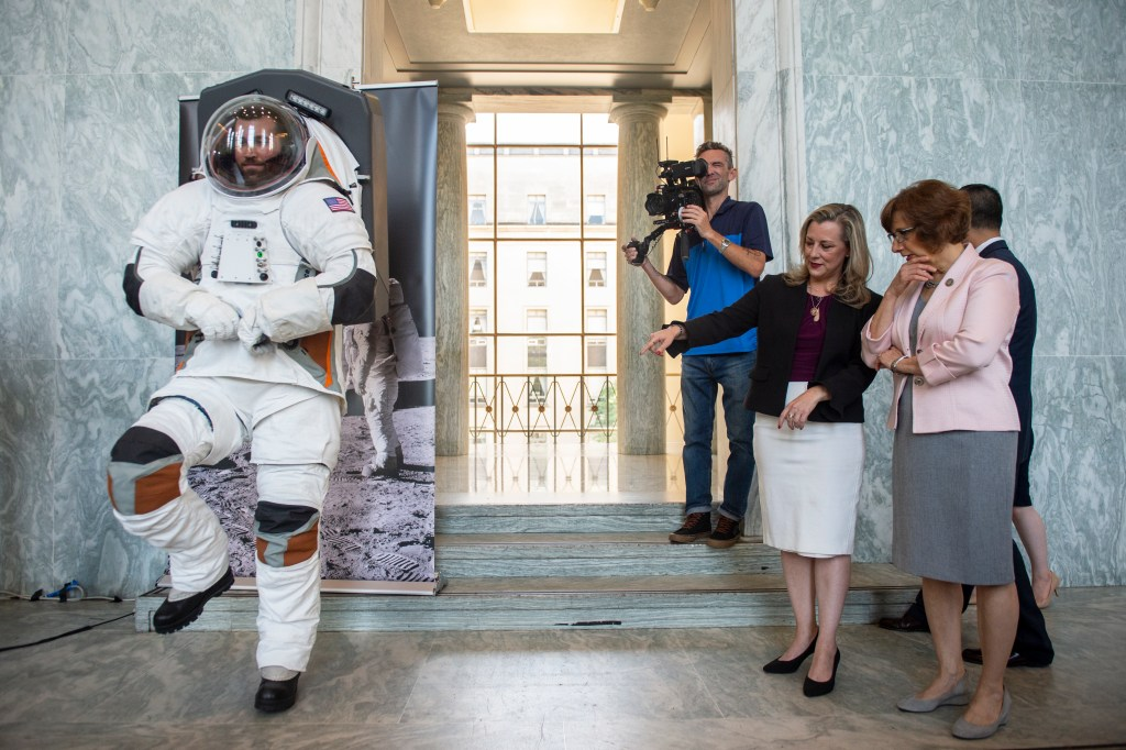 UNITED STATES - JULY 25: Rep. Suzanne Bonamici, D-Ore., right, and Space Subcommittee Chair Rep. Kendra Horn, D-Okla., look at a man modeling a possible prototype of the future suit for the upcoming mission to the moon in the Rayburn Building in Washington on Thursday July 25, 2019. (Photo by Caroline Brehman/CQ Roll Call)