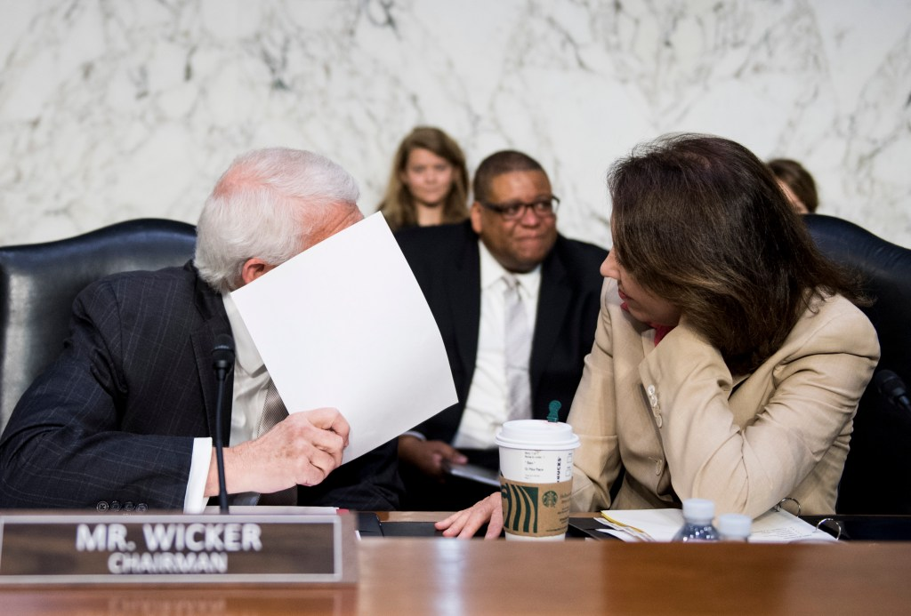 UNITED STATES - JULY 17: Chairman Sen. Roger Wicker, R-Miss., speaks with ranking member Sen. Maria Cantwell , D-Wash., before the start of the Senate Commerce, Science and Transportation Committee hearing on