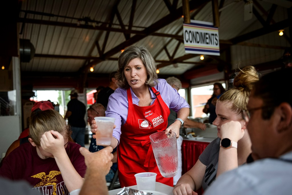 UNITED STATES - AUGUST 17: Sen. Joni Ernst, R-Iowa, pours waters at the Pork Tent at the Iowa State Fair on Saturday August 17, 2019. (Photo by Caroline Brehman/CQ Roll Call)
