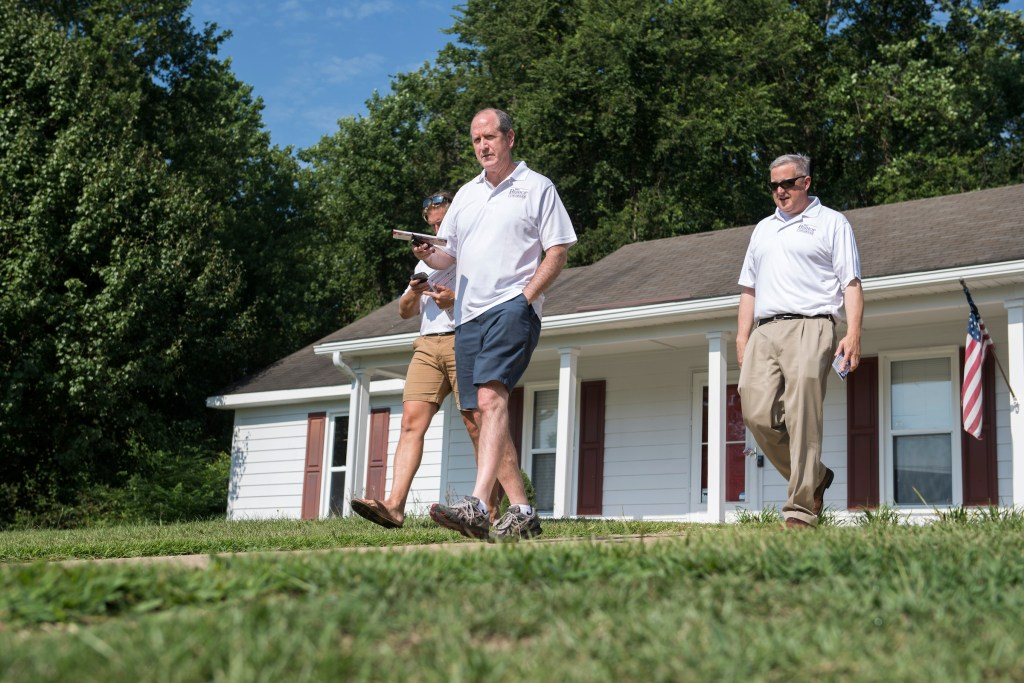 UNITED STATES - AUGUST 10: Dan Bishop, center, Republican candidate for North Carolina's 9th District, Michael Whatley, right, chairman of the N.C. Republican Party, and David Buzzard, canvas a neighborhood in Parkton, N.C., on Saturday, August 10, 2019. (Photo By Tom Williams/CQ Roll Call)