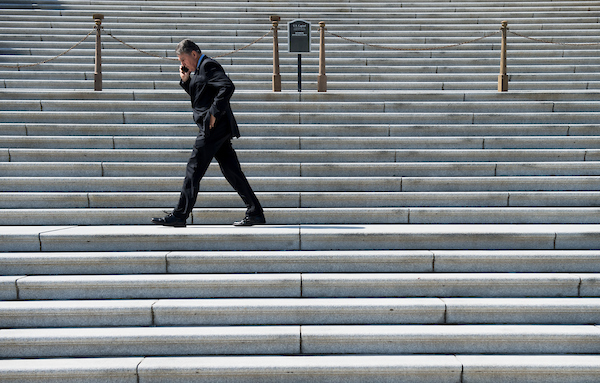 UNITED STATES - MARCH 14: Sen. Joe Manchin, D-W. Va., talks on his phone as he walks along the Senate steps before the vote on legislation to reverse President Trump's national emergency declaration concerning the U.S.-Mexico border on Thursday, March 14, 2019. (Photo By Bill Clark/CQ Roll Call)