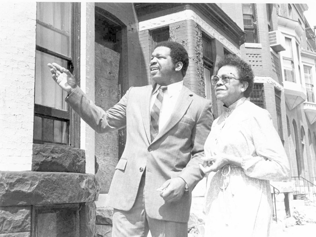 In the summer of 1982, Baltimore attorney Elijah E. Cummings (pictured on the left) visited a Baltimore neighborhood with his mentor, then-Maryland Delegate Lena K. Lee. Delegate Lee (pictured on the right), who was retiring from Maryland's House of Delegates, encouraged Cummings to run for her seat. .Cummings won the seat and served in the Maryland House until 1996, when he was elected to represent Maryland's 7th Congressional District in the U.S. House of Representatives. Recently, Congressman Cummings introduced legislation to officially rename the U.S. Post Office located at 1826 Pennsylvania Avenue in Baltimore, Maryland, as the