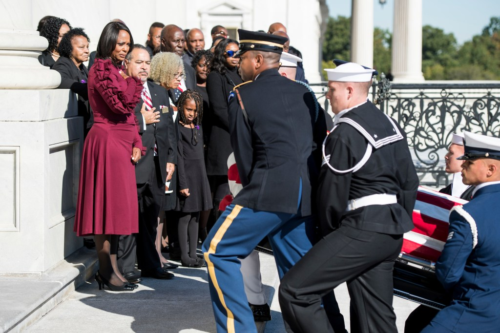 UNITED STATES - OCTOBER 24: Rep. Elijah Cummings' widow Maya Rockeymoore and family members look on as the flag-draped casket of Rep. Elijah Cummings, D-Md., is carried by members of the honor guard up the steps of the U.S. Capitol in Washington, on Thursday, Oct. 24, 2019. (POOL Photo By Bill Clark/CQ Roll Call)