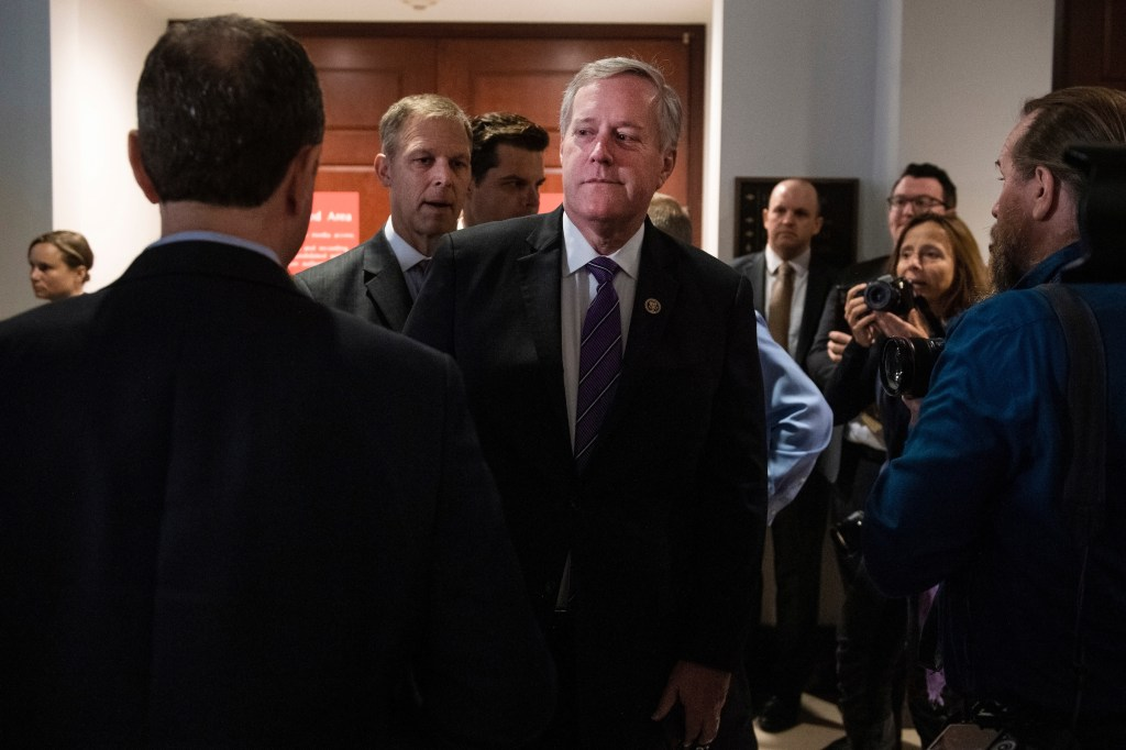 UNITED STATES - OCTOBER 8: Reps. Mark Meadows, R-N.C., right, passes House Intelligence Chairman Adam Schiff, D-Calif., left, outside a meeting in the Capitol Visitor Center where Gordon Sondland, U.S. ambassador to the European Union, did not appear for a deposition about President Trump's dealing with Ukraine on Tuesday, October 8, 2019. (Photo By Tom Williams/CQ Roll Call)