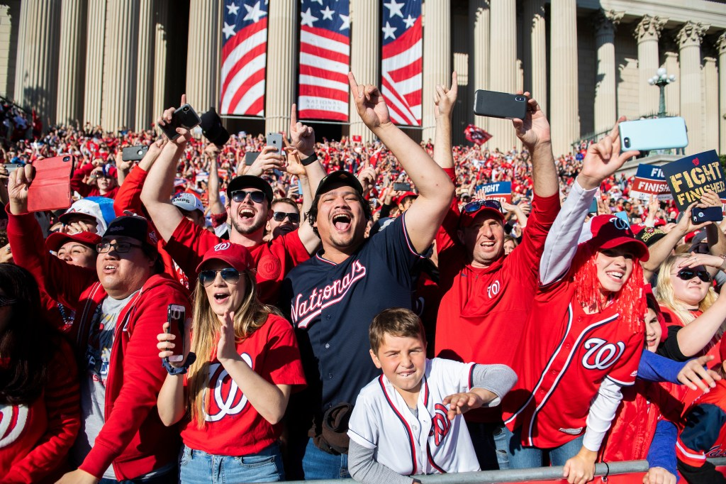 UNITED STATES - NOVEMBER 02: Fans in front of the the National Archives, cheer for the Washington Nationals Manager along Constitution Avenue during a parade to celebrate the World Series champions on Saturday, November 2, 2019. (Photo By Tom Williams/CQ Roll Call)