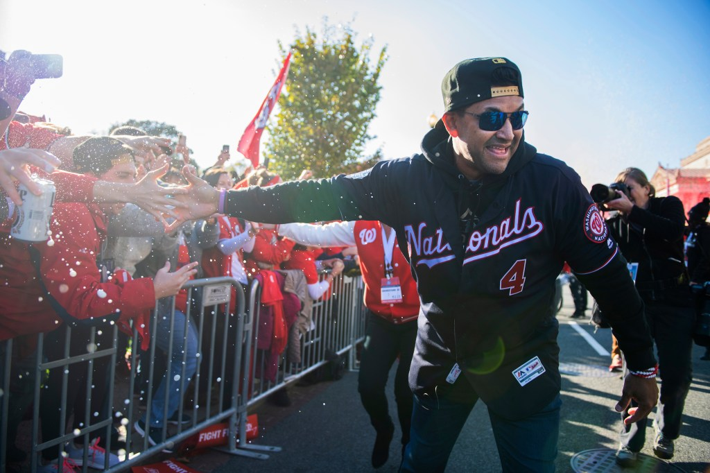 UNITED STATES - NOVEMBER 02: Washington Nationals manager Dave Martinez greets fans along Constitution Avenue during a parade to celebrate the World Series champions on Saturday, November 2, 2019. (Photo By Tom Williams/CQ Roll Call)