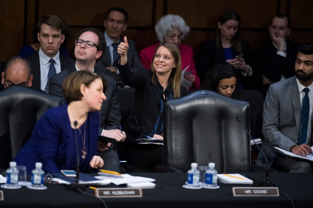 UNITED STATES - FEBRUARY 07: Erica Songer, chief counsel for Sen. Chris Coons, D-Del., votes for him by proxy, during a Senate Judiciary Committee hearing in Hart Building on judicial nominations including that of attorney general nominee William Barr, on Thursday, February 7, 2019. (Photo By Tom Williams/CQ Roll Call)