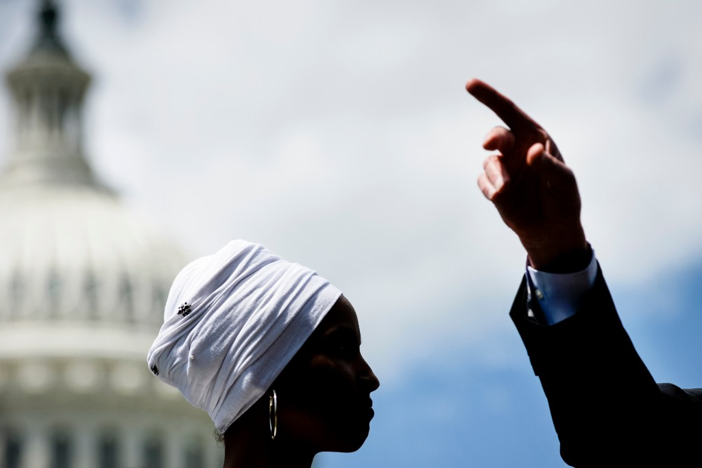 UNITED STATES - JUNE 24: Rep. Ilhan Omar, D-Minn., listens as Sen. Bernie Sanders, I-Vt., speaks during a news conference to discuss major college affordability legislation in Washington on Monday June 24, 2019. (Photo by Caroline Brehman/CQ Roll Call)