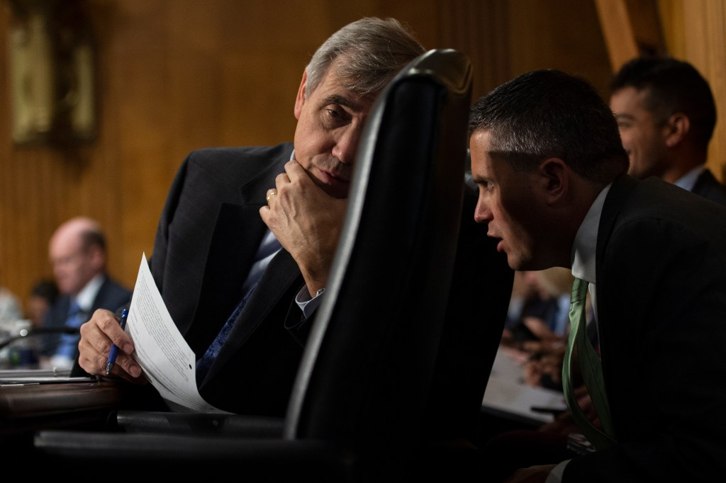 """UNITED STATES - DECEMBER 3: Sen. Jeff Merkley, D-Ore., speaks with a staffer during the Senate Foreign Relations Committee hearing on """"The Future of U.S. Policy Toward Russia"""" on Capitol Hill on Tuesday Dec. 3, 2019. (Photo by Caroline Brehman/CQ Roll Call)"""