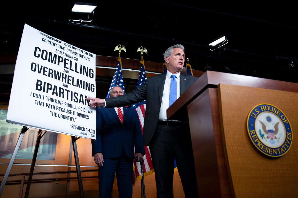 UNITED STATES - DECEMBER 3: House Minority Leader Kevin McCarthy, R-Calif., points to a poster as he speaks about the ongoing impeachment inquiry during a news conference on Capitol Hill on Tuesday Dec. 3, 2019. (Photo by Caroline Brehman/CQ Roll Call)
