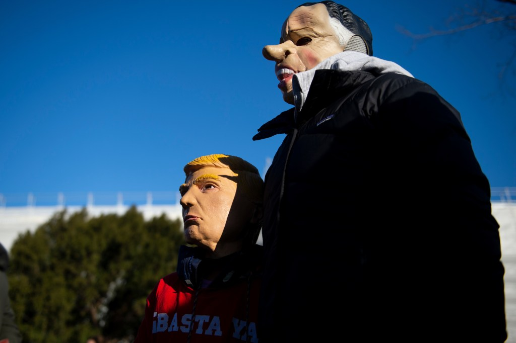 People rally in support of the impeachment of President Donald Trump in front of the Capitol as the House begins debate on the articles of impeachment on Wednesday. (Caroline Brehman/CQ Roll Call)