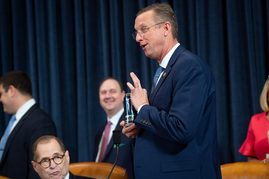 UNITED STATES - DECEMBER 4: Ranking member Rep. Doug Collins, R-Ga., holds up a Monster energy drink as he comes back from a recess during the House Judiciary Committee hearing on the impeachment inquiry of President Trump in Longworth Building on Wednesday Dec. 4, 2019. (Photo by Caroline Brehman/CQ Roll Call)