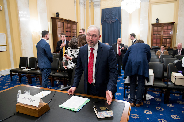 """UNITED STATES - NOVEMBER 14: Hugh Halpern, nominee to serve as Director of the Government Publishing Office, shows off a copy of """"Robert's Rules of Order"""" as takes his seat to testify during his confirmation hearing in the Senate Committee on Rules and Administration on Thursday, November 14, 2019. (Photo By Bill Clark/CQ Roll Call)"""