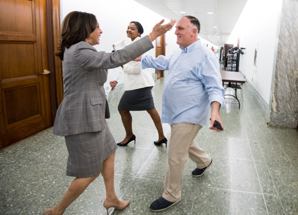 UNITED STATES - MAY 23: Sen. Kamala Harris, D-Calif., and chef Jose Andres hug after running into each other in the Dirksen Senate Office Building on Thursday, May 23, 2019. Andres was on Capitol Hill for a briefing held by the Power 4 Puerto Rico Coalition, calling on Congress to help Puerto Rico achieve future growth and prosperity after the devastation caused by Hurricane Maria. (Photo By Bill Clark/CQ Roll Call)