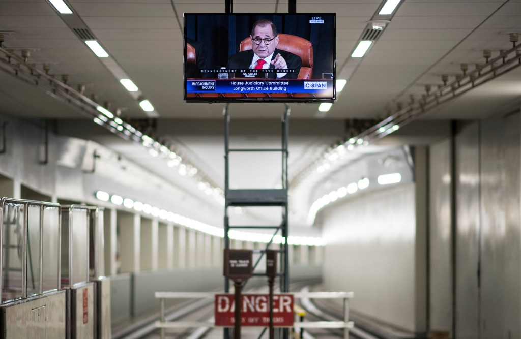 UNITED STATES - DECEMBER 9: Chairman Jerrold Nadler, D-N.Y., appears on a tv monitor in the Rayburn subway as he calls for a recess in the House Judiciary Committee hearing on