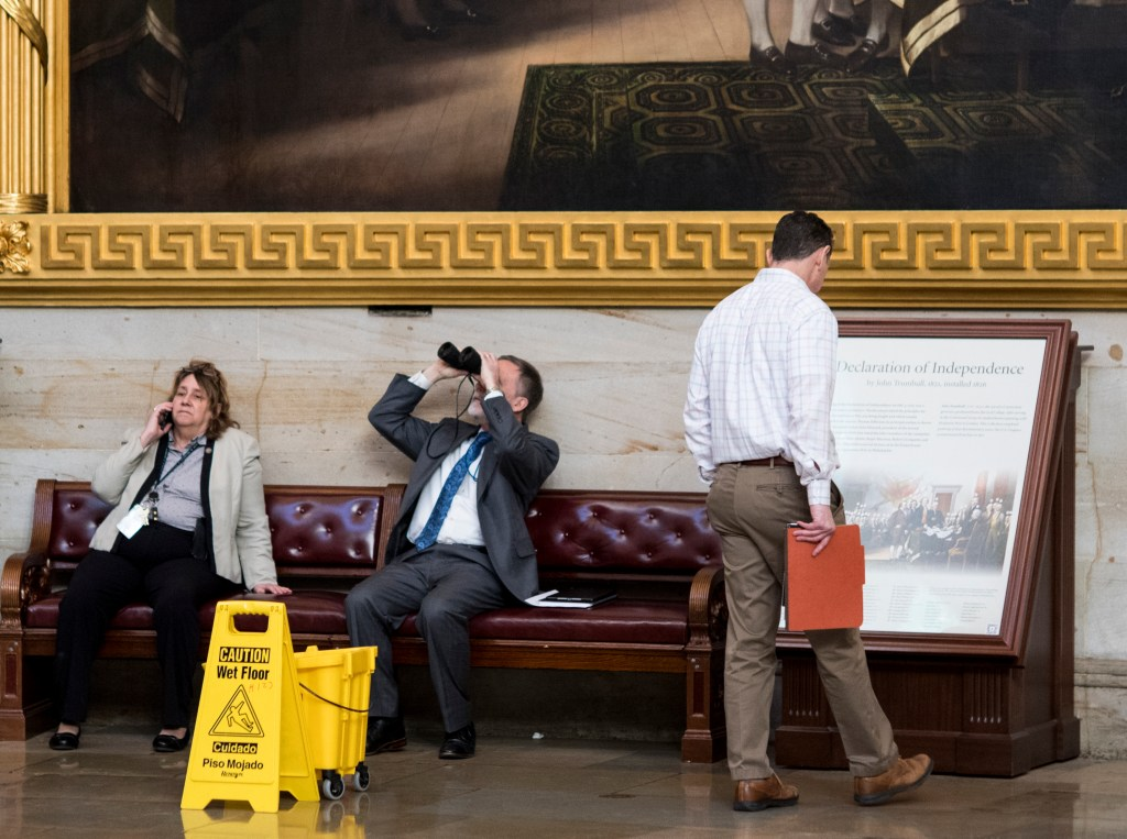 UNITED STATES - JANUARY 22: Capitol officials (checking with AOC on IDs/confirmation they are AOC officials) appear to check for signs of water dripping in the Capitol Rotunda on Tuesday morning, Jan. 22, 2019. The Architect of the Capitol office attributed the water to condensation accumulating on the window arches due to the extreme cold. (Photo By Bill Clark/CQ Roll Call)