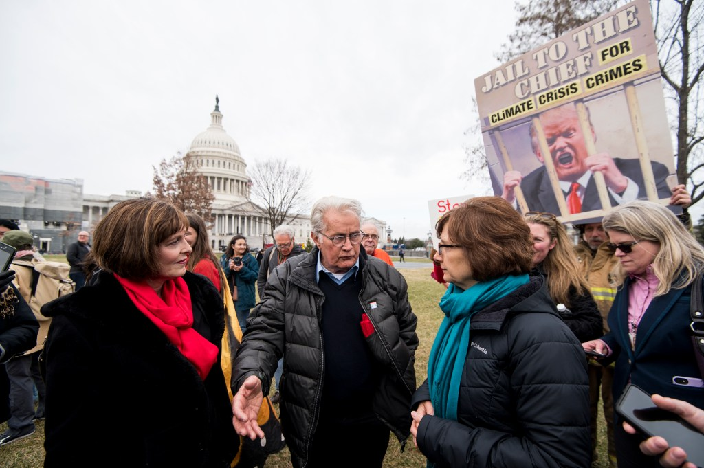UNITED STATES - JANUARY 10: From left, Rep. Kathy Castor, D-Fla., actor Martin Sheen, and Rep. Suzanne Bonamici, D-Ore., talk at Jane Fonda's weekly Fire Drill climate protest outside the Capitol on Friday, Jan. 10, 2020. (Photo By Bill Clark/CQ Roll Call)