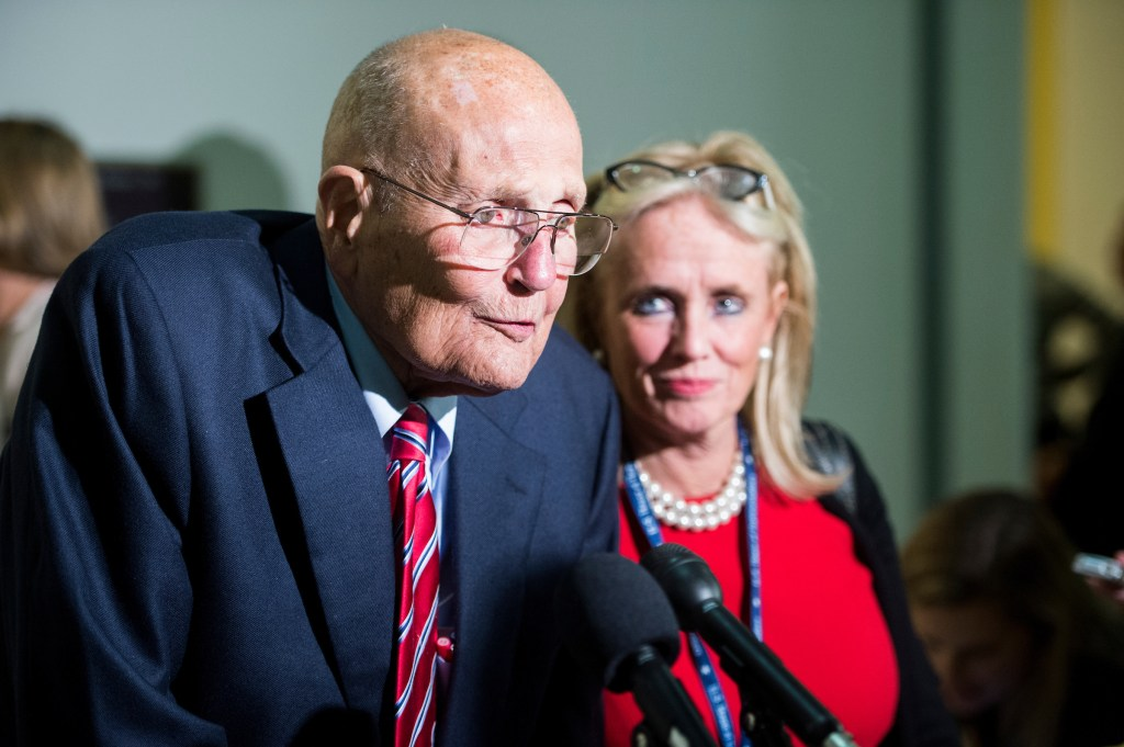UNITED STATES - NOVEMBER12: Rep. John Dingell, D-Mich., and his wife Rep.-elect Debbie Dingell, D-Mich., speak with reporters as they arrive for the 114th Congress Member Reception in the Cannon House Office Building on Wednesday, Nov. 12, 2014. (Photo By Bill Clark/CQ Roll Call)