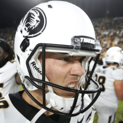 This white helmet with the standard Mizzou logo in black was worn during the Purdue win